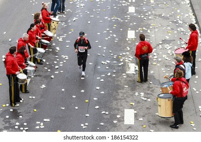 Rotterdam, The Netherlands - April 11, 2010:: Competitor being urged on by street band in the 30th edition of the ABN AMRO Rotterdam Marathon.