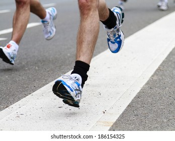 Rotterdam, The Netherlands - April 11, 2010: Athletes running past in the 30th edition of the ABN AMRO Rotterdam Marathon held in the city center.