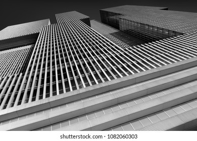 ROTTERDAM, THE NETHERLANDS – APRIL 16, 2018: Black-and-white image of a modern skyscraper (De Rotterdam) designed by Dutch architect Rem Koolhaas.