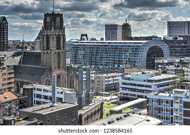 Rotterdam, the Netherlands, April 18, 2015: two prominent buildings in the city center, late-gothic Saint Lawrence church and recently completed Markthal