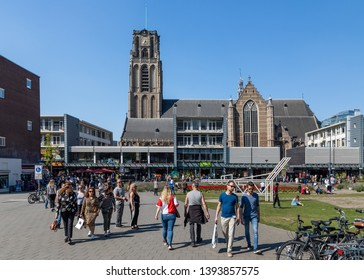 Rotterdam, The Netherlands - April 20 2019: People enjoy a sunny April day on the square between Sint Laurenskerk and and Markthal