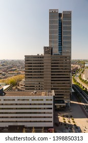 "Rotterdam, The Netherlands - April 20 2019: The towers of ""PS Premier Suites & Offices"" (now owned by Premier Suites Plus) and the FIRST Rotterdam, headquarters of Robeco."