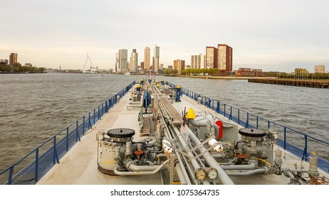 Rotterdam Netherlands April 2018, Inland gas tanker transporting gas over the river Maas with the skyline of Rotterdam in front of the ship