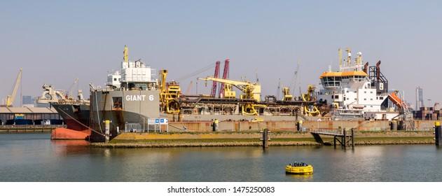 Rotterdam, The Netherlands - April 21 2019: Deck Cargo Pontoon GIANT 6 now renamed KEPPEL NANTONG 043 (IMO 9725665) and Hopper Dredger PRINS DER NEDERLANDEN (IMO 9263899) at the Port of Rotterdam