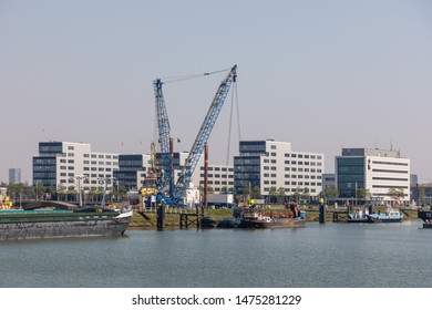 Rotterdam, The Netherlands - April 21 2019: Office buildings at the eastside of Waalhaven at Woudrichemstraat, hosting inter alias Hapag-Lloyd Rotterdam, Samskip, ClearVision Ship Management