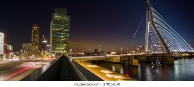 ROTTERDAM, NETHERLANDS - APRIL 6: KPN building in Rotterdam in a panorama of the skyline at dusk during the blue hour with the erasmus bridge illuminated, on April 6, 2015, in Rotterdam, Netherlands