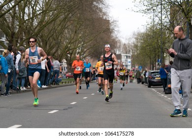 Rotterdam, Netherlands. April 8 2018. Athletes run along Mariniersweg during the Rotterdam Marathon. Conditions were very warm with a temperature high of 21C. The marathon is known for its fast times.