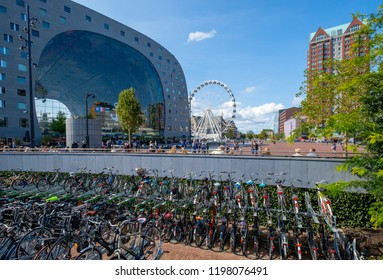 ROTTERDAM, THE NETHERLANDS - AUG 30, 2018 : View on the chracteristic arch of the market hall in Rotterdam, Netherlands. In front lots of bicycles.