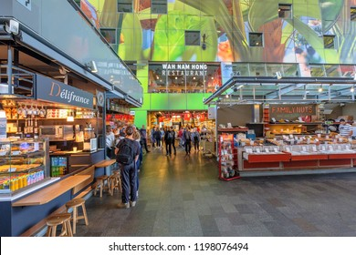 ROTTERDAM, THE NETHERLANDS - AUG 30, 2018 : Shopping people inside the beautiful artistic market hall of Rotterdam. Residential homes and offices are in the arch of this building.