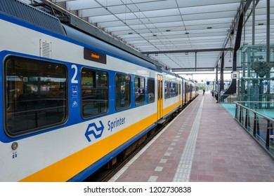 ROTTERDAM, THE NETHERLANDS - AUG 30, 2018 : Dutch sprinter train is about to depart from a platform at the central station in Rotterdam, the Netherlands.