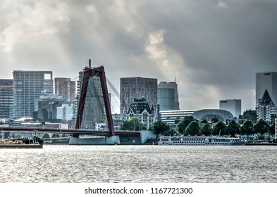 Rotterdam, The Netherlands, August 13, 2018: View from the Nieuwe Maas river towards the city center, with Willemsbridge, the White House and Markthal