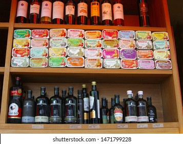 ROTTERDAM, NETHERLANDS - August 2, 2019. Assortment of typical Portuguese products like wine bottles, vinegar, Minerva tinned fish fillets, sardines in olive oil. Food store in Markthal, market hall.