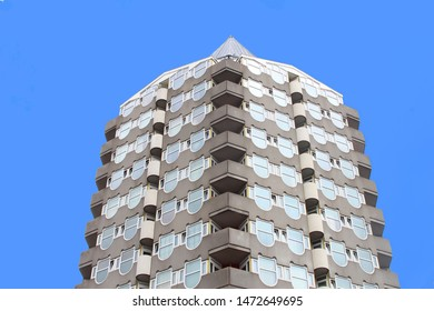 ROTTERDAM, NETHERLANDS - August 2, 2019. Modern tower building with apartments, curved glass windows and balconies for starters and students at Blaak street. Housing shortage problems in Holland.