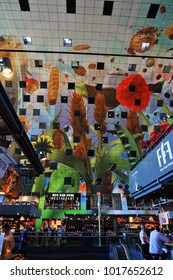 Rotterdam, Netherlands - August 24, 2016: the Markthal - market hall in central Rotterdam famous for the colourful design of it's ceiling and walls