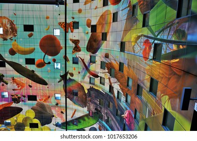 Rotterdam, Netherlands - August 24, 2016: the Markthal - market hall in central Rotterdam famous for the colourful design of it's ceiling