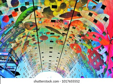 Rotterdam, Netherlands - August 24, 2016: the colourful painted arch ceiling of the Markthal - famous market hall in central Rotterdam