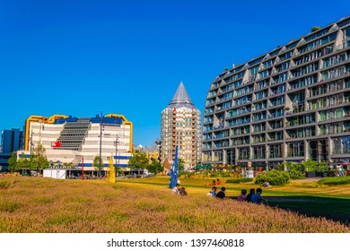 ROTTERDAM, NETHERLANDS, AUGUST 5, 2018: View of the Central library, Blaak tower and Markthall in Rotterdam, Netherlands