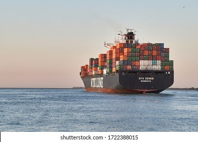 ROTTERDAM, THE NETHERLANDS - CIRCA 2019: Container ship heading out to the North Sea from the Port of Rotterdam. Vessel of Nyk Line, Nippon Yusen Japanese shipping company