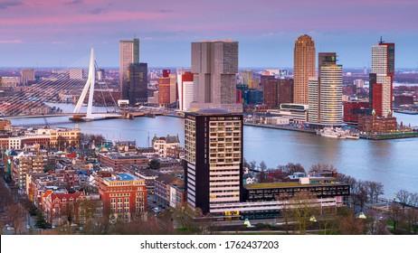 Rotterdam, Netherlands, city skyline over the Nieuwe Maas River at twilight.