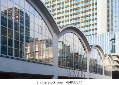 Rotterdam, Netherlands - Dec 18, 2017 : Rotterdam cruise terminal arch windows with buildings in the background.