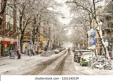 Rotterdam, The Netherlands, December 10, 2017: View along downtown Witte de Withstraat after de-icing salt and traffic have turned recently fallen snow into a grey brown slush