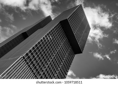 ROTTERDAM, THE NETHERLANDS – DECEMBER 29, 2013: Black-and-white image of a skyscraper (De Rotterdam) designed by Dutch architect Rem Koolhaas.