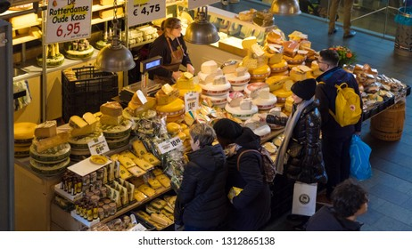 Rotterdam, the Netherlands - February 1, 2019: Customers at a cheese stall in the Markthal.