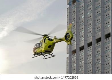 Rotterdam, The Netherlands, February 13, 2019: traumahelicopter (rescue chopper) in flight next to the facade of Erasmus MC medical center