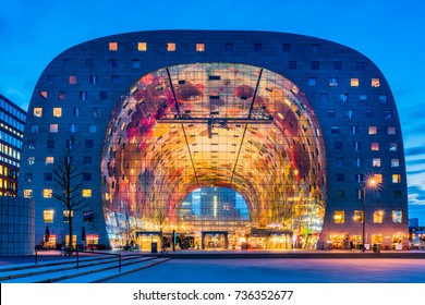 Rotterdam, Netherlands - February 2, 2017: Market Hall in the Blaak district of Rotterdam, Netherlands at dusk. It is a residential and office building with a market hall underneath.