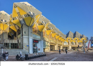 ROTTERDAM, THE NETHERLANDS - FEBRUARY 23, 2018: Cube houses (Kubuswoningen) - city most iconic attractions. Architect tilted a traditional, cube-shaped house 45 degrees and lifted it on a pylon.