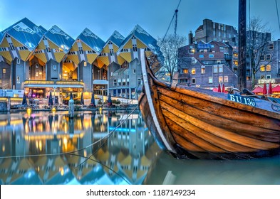 Rotterdam, The Netherlands, February 26, 2016: A historic barge is moored in the Old Harbour, with the Cube Houses in the background