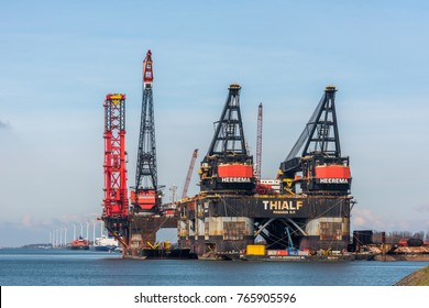 ROTTERDAM, THE NETHERLANDS - FEBRUARY 28, 2016: The semi submersible crane vessel Thialf  moored at the Calandkanaal near Rozenburg for maintenance in the Port of Rotterdam, The Netherlands.