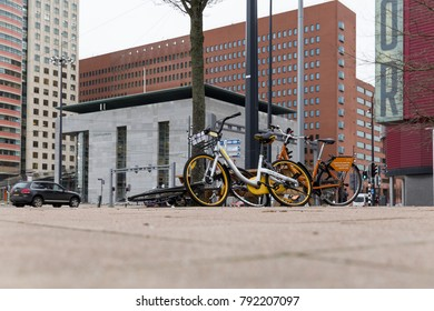 Rotterdam, Netherlands - January 2, 2018: Bicycles in the city of Rotterdam. The yellow oBikes are a new means of semi public transport in the city.