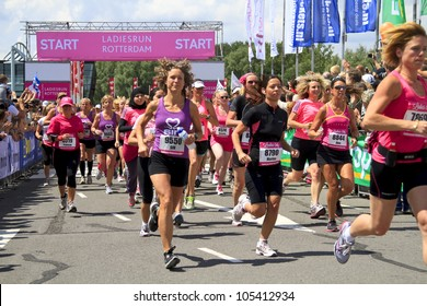 ROTTERDAM, THE NETHERLANDS - JUNE 10 2012: Contestants pass by at the start of the race in the annual Ladiesrun 10 KM event held on Sunday June 10,  2012 in Rotterdam.