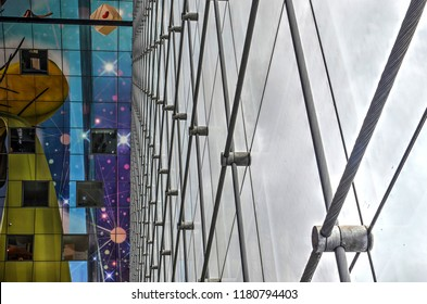 Rotterdam, The Netherlands, June 20, 2015: the innovative glass facade supported by steel cables in the Markthal multipurpose building by MVRDV architect (2014)