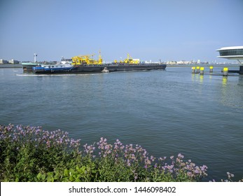 ROTTERDAM, THE NETHERLANDS - JUNE 28, 2018: car wash for seagoing vessels and barges, oil barriers laid out, necessary after the oil spill when a bulk tanker crashed into a jetty on June 23.