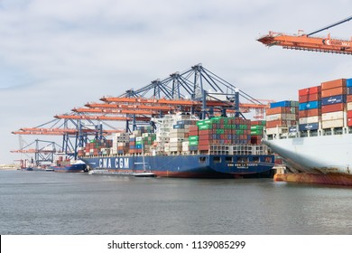 Rotterdam, The Netherlands - June 5 2018: Container terminal in Dutch harbor Rotterdam with cargo ships moored for loading and unloading freight