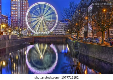 Rotterdam, The Netherlands, March 12, 2017: Ferris Wheel the View reflected in a canal called Steigergracht in Rotterdam.