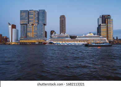 Rotterdam, Netherlands - March 12th, 2020: Cruise ship and modern buildings in Rotterdam