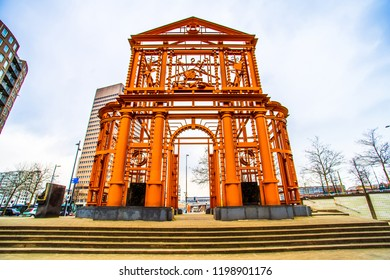 Rotterdam, Netherlands - March 23, 2018 - Street view of New Delft Gate (Nieuwe Delftse Poort), with the memorial 50 years reconstruction Rotterdam, by the artist Cor Kraat, Pompenburg