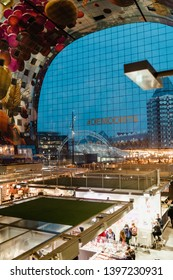Rotterdam, Netherlands - March 30, 2019; Market Hall indoor at the evening time. The Markthal is a residential and office building with a market hall underneath, located in Rotterdam.