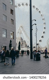 Rotterdam, Netherlands - March 30, 2019; Hoogstraat square view on Markthal and Ferris Wheel on sunny weather.