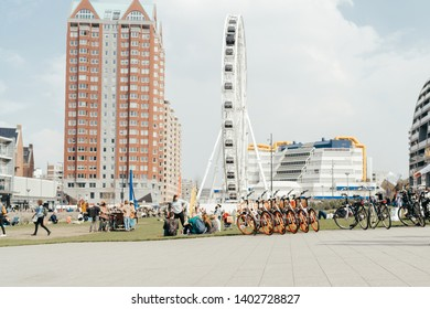 Rotterdam, Netherlands - March 30, 2019; Street view on ferris wheel near Markthal, people walking and bicycle parking is on the front in Rotterdam on the sunny day.