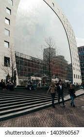 Rotterdam, Netherlands - March 30, 2019; Side view on Markthal on the sunny day. The Markthal is a residential and office building with a market hall underneath, located in Rotterdam.