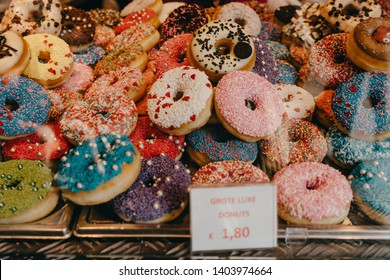 Rotterdam, Netherlands - March 30, 2019; Markthal food court selling doughnuts, cannoli, Dutch white and blue box and mint.