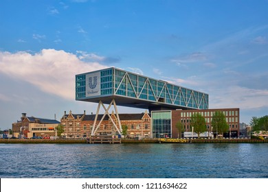 ROTTERDAM, NETHERLANDS - MAY 11, 2017: Unilever Bestfoods headquarters building De Brug (The Bridge) built over an existing historical factory from 1891 designed by architect Chris de Jonge
