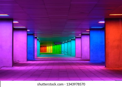 ROTTERDAM, NETHERLANDS - MAY 11, 2017: Colorful mulitcolored illuminated gallery tunnel rainbow passage installation under NAI building, Nederlands Architecture Institute near MuseumPark, Rotterdam