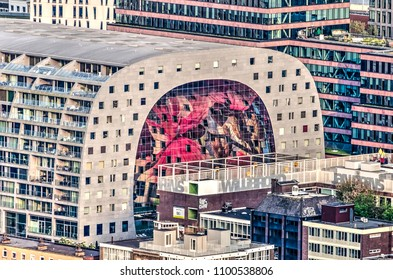 Rotterdam, The Netherlands, May 11, 2018: apartment building and shopping cathedral Markthal with it's colorful interior catches the last rays of the sun