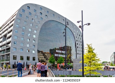 ROTTERDAM, NETHERLANDS - MAY 12, 2018: People walking near Markthal and exploring local landmarks at sunset. Negative copy space, place for text