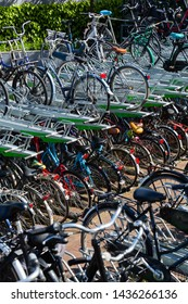 ROTTERDAM, THE NETHERLANDS - MAY 15 2019: Many bicycles parked at a public parking lot in the center of the city.